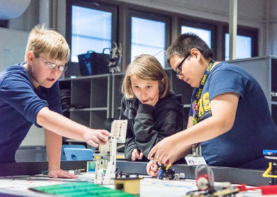 kids working with lego robotics
